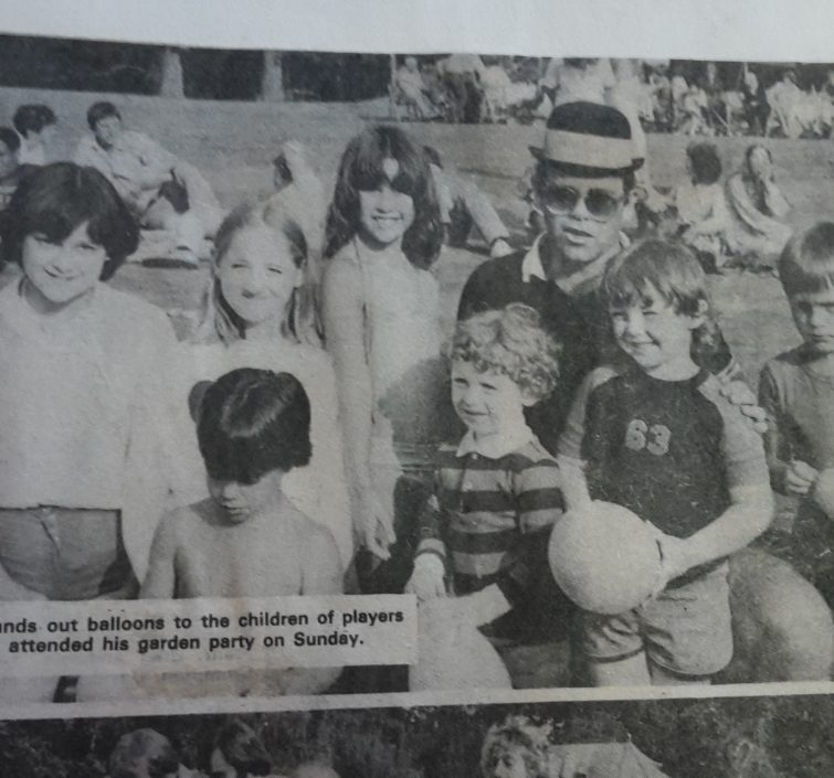 Elton John with the children of players